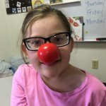 Student with red nose